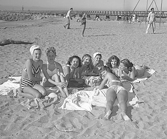 1947 in the United States - Girls sunbathing at Cabrillo Beach, California, Dec. 28, 1947