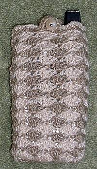 Crochet Stitches Wiki : cell phone cover made from shell stitch crochet in two colors.