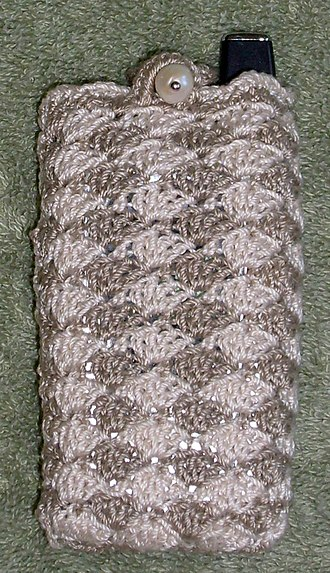 Shell stitch - A cell phone cover made from shell stitch crochet in two colors.