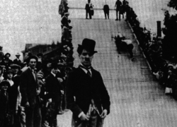 "Kid Auto Races in Venice (1914): Chaplin's second film and the début of his ""tramp"" costume."