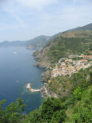 Cinque Terre - A view of the National Park of the Cinque Terre with Riomaggiore, one of the five coastal villages, directly below.