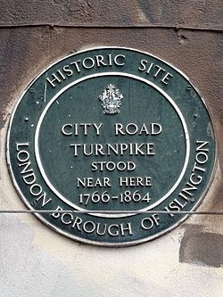 Photo of City Road Turnpike green plaque