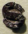 Cividale, man, fibula a S in argento dorato, da necropoli cella 18 con granati almandini.jpg