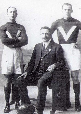 "Bert Rankin - Cliff and Bert Rankin standing with their father, Edwin ""Teddy"" Rankin, on the occasion of the sons' selection in the 1923 Victorian state team"