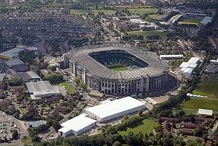 "Aerial view of <a href=""http://search.lycos.com/web/?_z=0&q=%22Twickenham%20Stadium%22"">Twickenham Stadium</a> (centre) and <a href=""http://search.lycos.com/web/?_z=0&q=%22Twickenham%20Stoop%22"">Stoop Stadium</a> (background) from the north in August 2015"