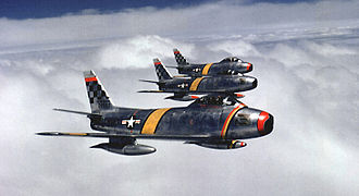 North American F-86 Sabre - Three F-86s flying in formation over Korea in 1953