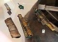 Conglomerati di oggetti metallici fusi durante il rogo funerario, da tomba di artiaco 104, 700 ac ca. (mann).jpg