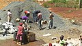 Construction site workers loading water, sand, ballast and cememt into a concrete mixer in Embu, Kenya 4.jpg