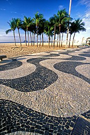 Famous Portuguese pavement wave pattern at Copacabana beach.