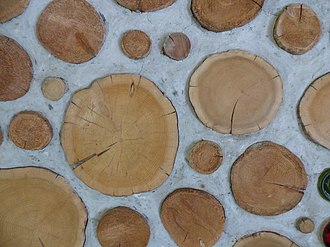 """Cordwood construction - Cordwood masonry wall detail, also called """"cordwood construction"""" or """"stackwall"""" because the wall resembles a stack of cordwood."""