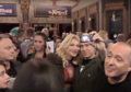 Courtney Love taking photograph with fan.png