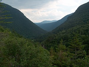 Crawford Notch - Present-day Crawford Notch, looking south from Elephant Head rock (visible to left of notch in Thomas Cole painting)