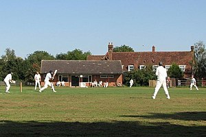 Boundary (cricket) - A batsman scoring a six during a game at Chrishall, Essex