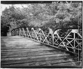 DETAIL VIEW OF EAST TRUSS WITH DECK - Bridge of Pines, Ermatinger Drive in Irvine Park, Chippewa Falls, Chippewa County, WI HAER WIS,9-CHIFA,1-3.tif