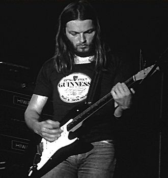 David Gilmour - Gilmour performing live with Pink Floyd in the mid-1970s