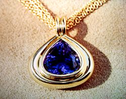 Deep blue tanzanite and yellow gold.jpg
