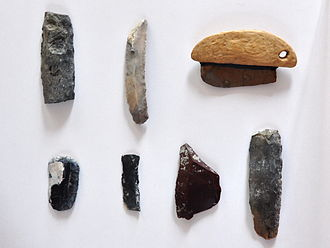 Prehistoric pile dwellings around Lake Zurich - Seegubel: Remains of the stone axe making, including tees, pieces with saw wafers, semi-finished products and finished blades, which show the manufacturing processes.