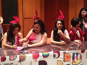 Dim Sum Dollies - The Dim Sum Dollies signing autographs following their show Dim Sum Dollies: The History of Singapore Part 2 at the Esplanade – Theatres on the Bay, in December 2014. From left to right are Pamela Oei, Selena Tan and Denise Tan.