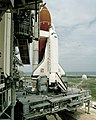 Discovery and launch platform during STS-31 prelaunch preparations.jpg