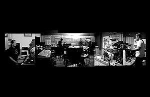 English: Band photo of Djam Karet in the studio