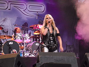 Doro (musician) - Doro performing live at Norway Rock Festival in 2009; drummer Johnny Dee in the background.