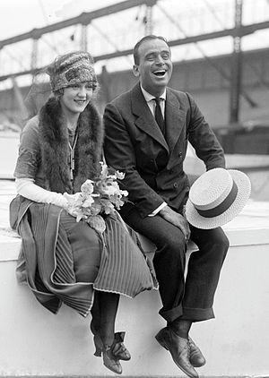 1920s in Western fashion - Actors Douglas Fairbanks and Mary Pickford on board the SS Lapland wearing fashions of the early 1920s