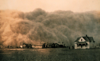 Dust - A dust storm blankets Texas homes, April 1935