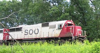 Soo Line Railroad -  Soo Line 6022, an EMD SD60, pulls a train through Wisconsin Dells, WI, June 20, 2004.