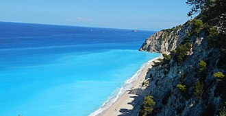 Tourism in Greece - The Egremnoi sand beach in the Greek island of Lefkada, noted for its blue crystal waters, is a popular tourist destination.