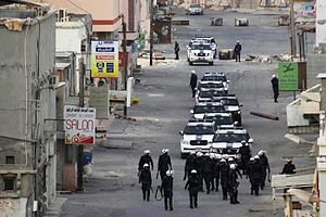 Aftermath of the Bahraini uprising (September–December 2012) - Bahraini security forces and police SUVs patrolling the besieged village of Eker, on 20 October 2012