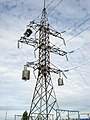 Electricity pylon with line traps and optical fiber cable.jpg