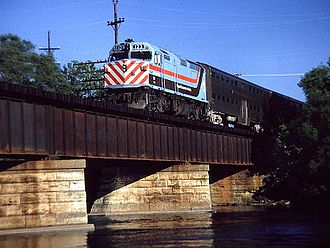 Metra - RTA EMD F40PH No. 123 crossing the Fox River in Elgin, Illinois in 1981