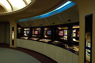 USS Enterprise (NCC-1701-D) - The aft stations on the bridge, from left to right: Science I, Science II, Environment, Mission Ops, and Engineering