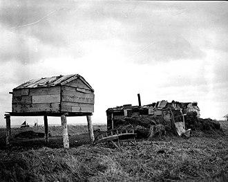 Nushagak, Alaska - Food cache and barabara sod hut in Nushagak, 1917