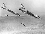 F-8J Crusaders of VFP-63 drop bombs at Chocolate Mountain Aerial Gunnery Range 1972.jpg