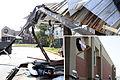 FEMA - 35506 - Force of EF2 tornado impales board into concrete wall.jpg