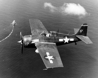 USS Santee (CVE-29) - An FM-2 flying over Santee in October 1944.