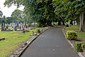 Footpath past Ian Curtis's grave marker, Macclesfield Cemetery.jpg