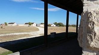 Fort Stockton, Texas - Parade ground and barracks as seen from the guard house:  The museum is in the barracks on the right.