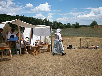 British soldiers in the eighteenth century - Camp followers were an ubiquitous part of British military life during the 18th century (historical reenactment).