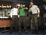 From left, U.S. Marine Corps Cpl. Clermon Candio, Sgt. John Cummings and Cpl. Joshua Duso, all with Marine Fighter Attack Squadron (VMFA) 323, sing karaoke on the aircraft carrier USS Nimitz (CVN 68) in the U.S 130818-N-AZ866-055.jpg