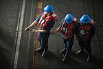From left, U.S. Navy Seamen Tyler Truong, William Aldavera and Brionna Peterson heave in a line in the hangar bay of the aircraft carrier USS Harry S. Truman (CVN 75) during a replenishment at sea in the Gulf 140101-N-ZG705-276.jpg