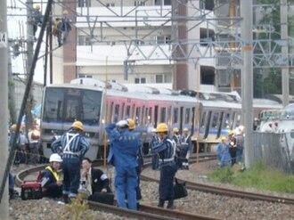 2005 in rail transport - Investigation at the scene of the Amagasaki rail crash.