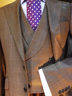 Herrenmode 2011 in London. Anzug mit Weste und...