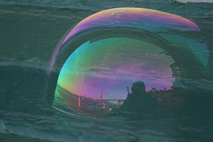 "Altered colors of skylight reflected in a soap bubble, due to thin-film interference (formerly called ""thin-plate"" interference). Ggb in soap bubble 3.JPG"