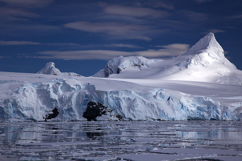 File:Glacier on Antarctic coast, mountain behind.jpg