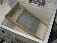 A 20th century glass washboard