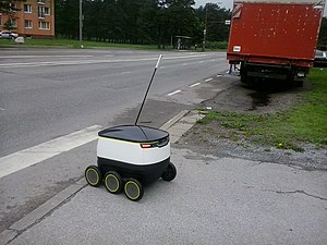 Starship Technologies - Starship delivery robot preparing to cross the street.