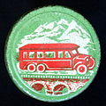Groen rond blikje met rode autobus.JPG