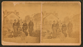 Group portrait of two men and three women taken in the garden, by Anderson.png